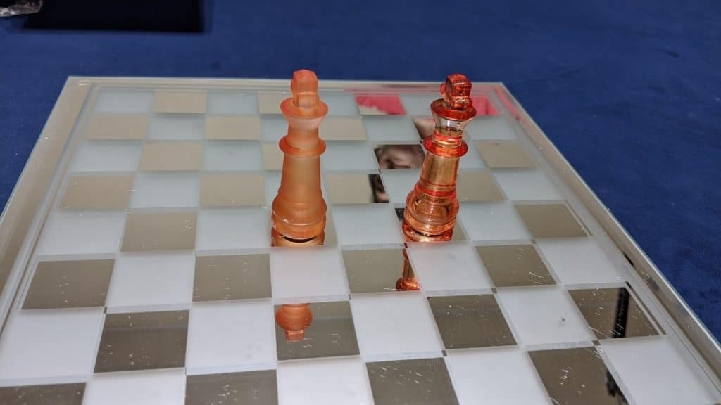 two kings on glass chess board