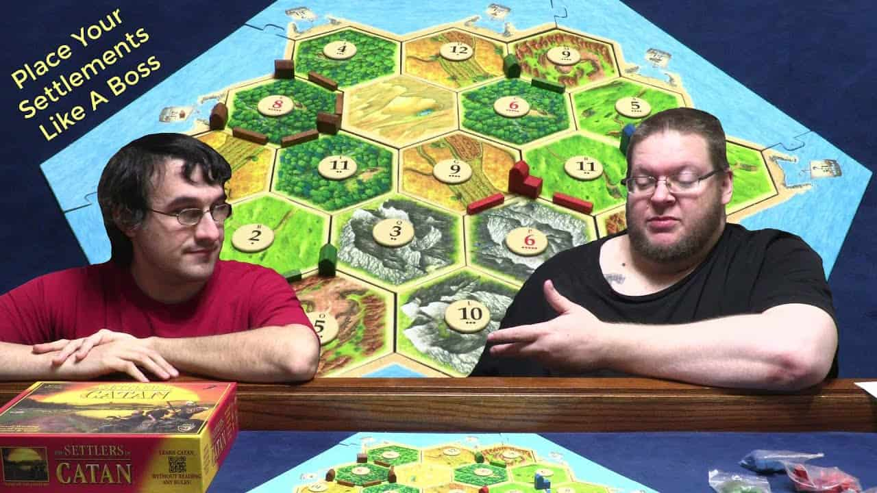 two gamers playing settlers of catan