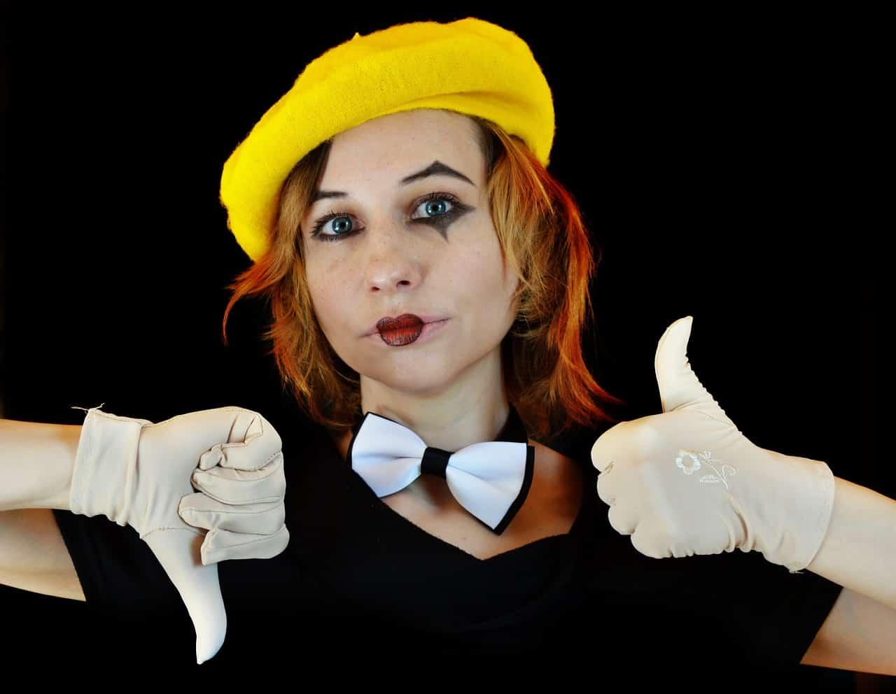clown mime thumbs up thumbs down