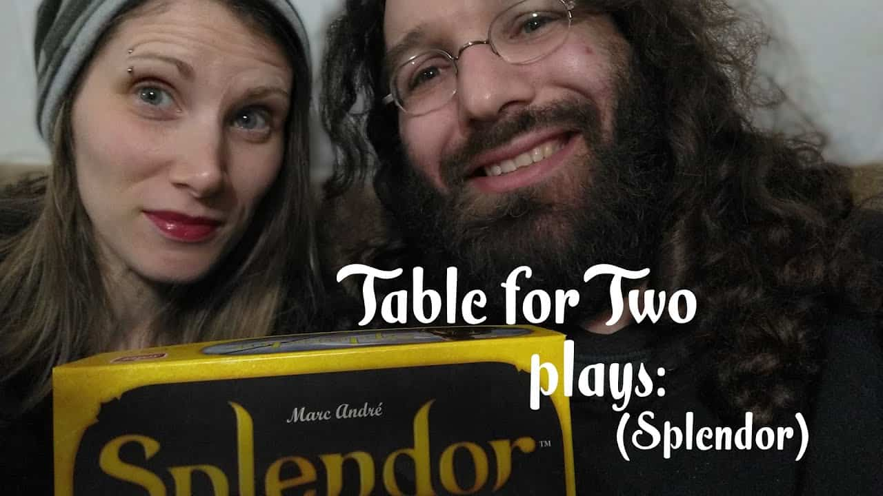 gaming couple with splendor boardgame