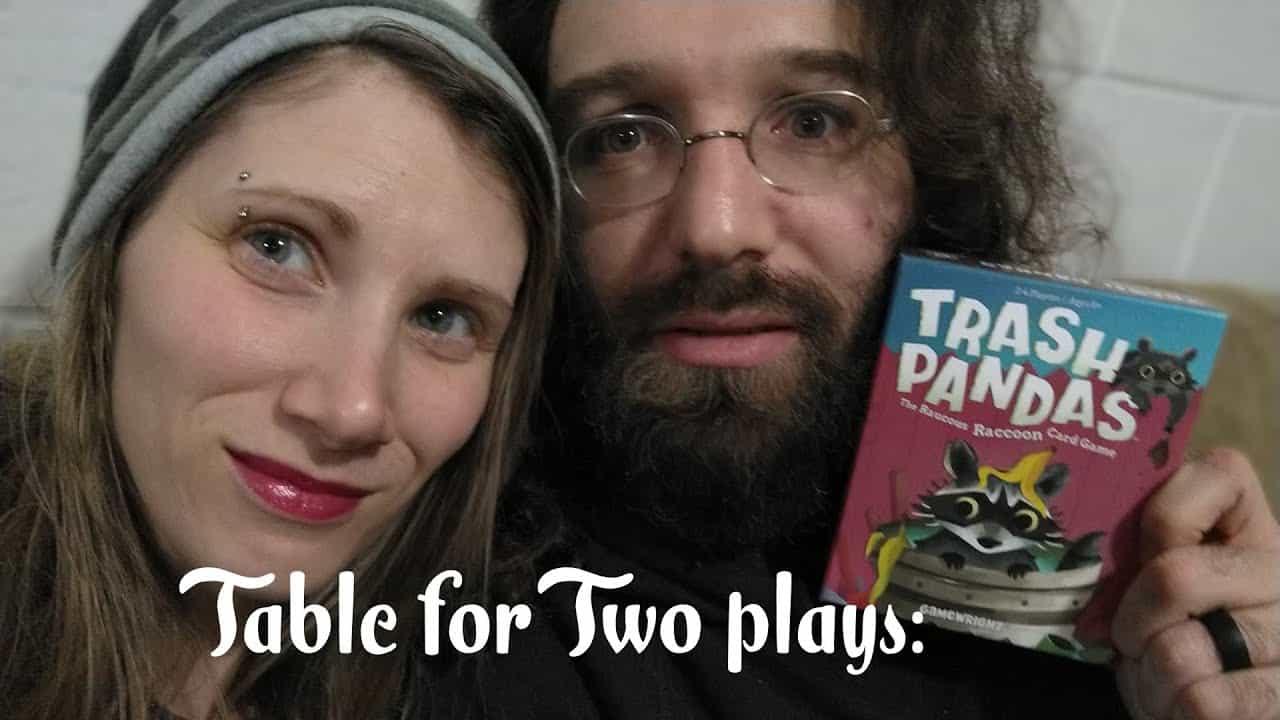 gamers holding trash pandas card game