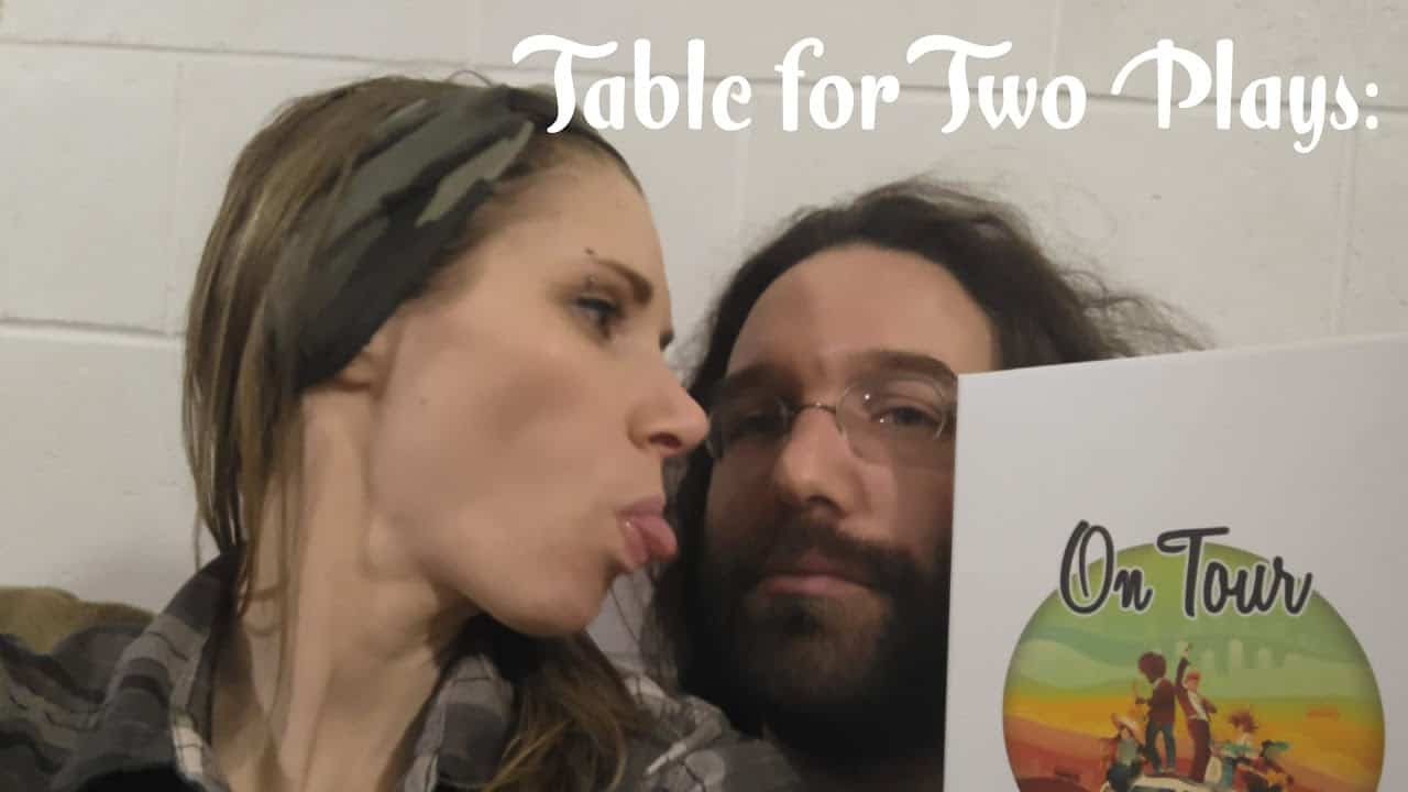 gaming couple playing On Tour boardgame