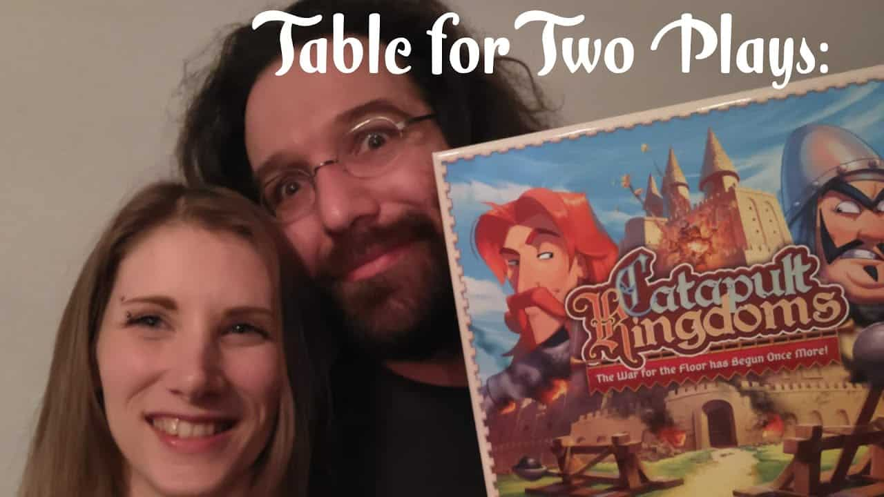 catapult kingdoms board game with gaming couple