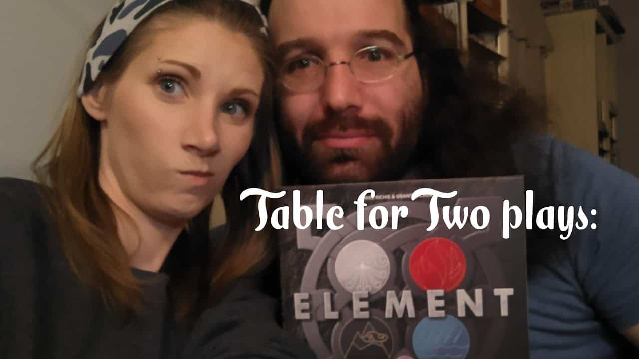Element board game with married gamer couple