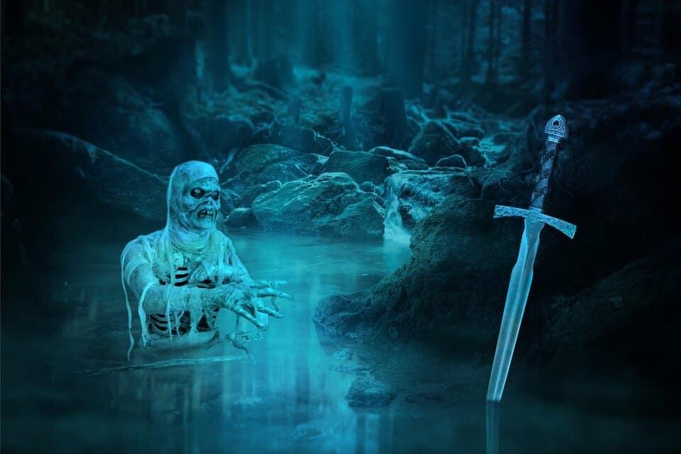 undead skeleton reaching for mystical sword